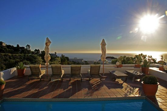 Relax on the pool at dusk, above the mighty Atlantic, below majestic Table Mountain